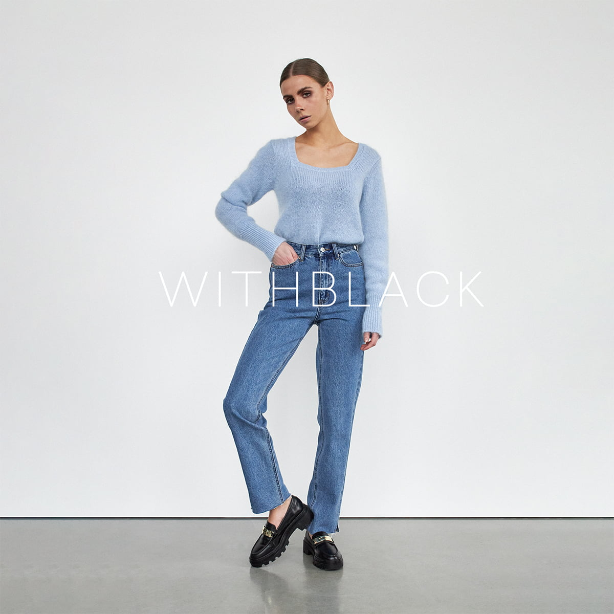 Model with a knit pullover and jeans