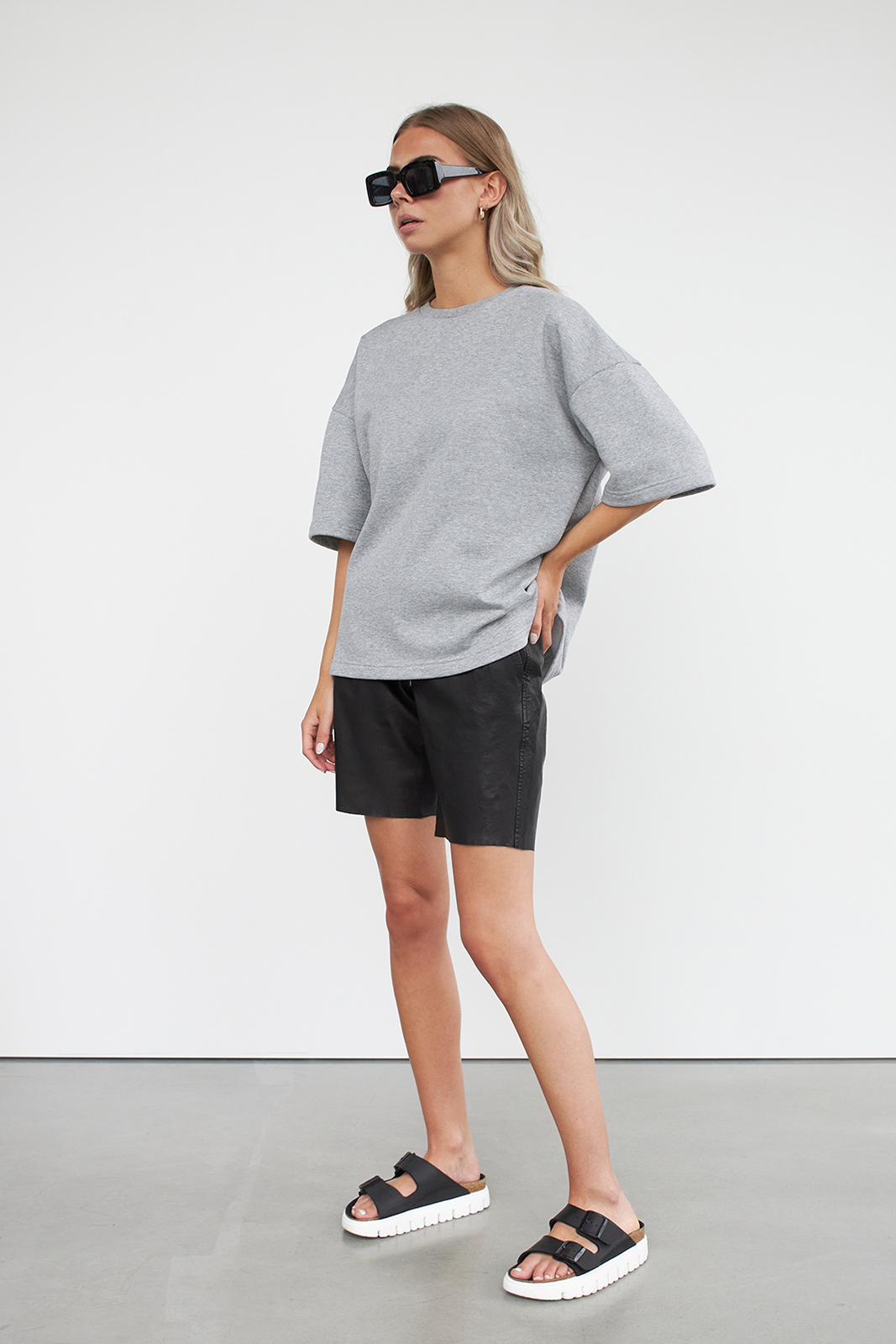 woman wearing t-shirt and leather shorts