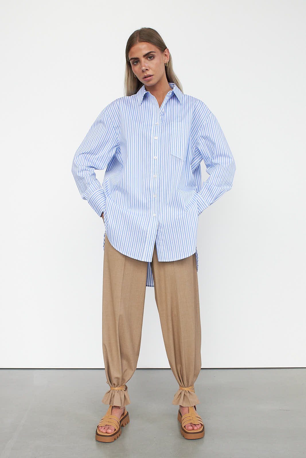woman wearing shirt and loose trousers